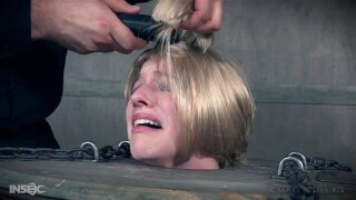 Nerdy blonde cutie Riley Nixon gets her hair cut in extreme bondage
