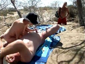 A Horny Couple Is Getting Ready For The Sex On The Nudist Beach. The Slut Is Jerking Her Lover's Hard Schlong. Porn