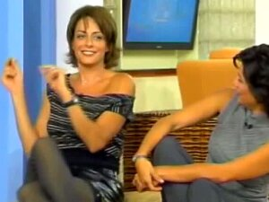 Sexy Brunette Milf In A Revealing Dress Crosses Her Legs In Hot Pantyhose On Tv So Everyone Can Gaze At Her Thongs And Wet Pussy Under Them Porn