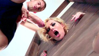 Kate England sucks monster cock in the pillory