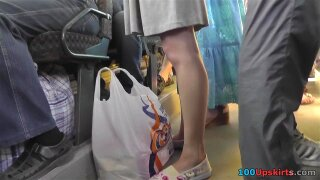 Public transport upskirt scene presents brunette peach with outstanding skinny ass covered with boring classic panties.