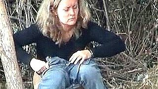 A hawt outdoor pissing scene caught on a spy web camera by a voyeur