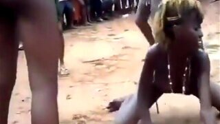 This meaty African woman swings around with the other skinny girls while her butt flies around with all those layers of fat. She doesn't really care for what others think.