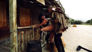 Busty brunette babe gets a hardcore banging wild west style