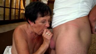 Brunette granny still in great shape to ride lover's dick